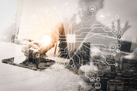 Artificial Intelligence (AI),machine learning with data mining technology on virtual dachboard.Double exposure of success businessman working in office with digital tablet laptop computer with London building. Stock Photo