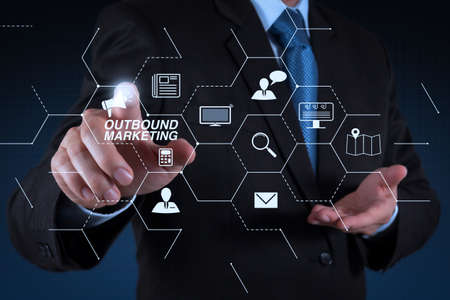 Outbound marketing business virtual dashboard with Offline or interruption marketing.businessman hand  working with touch screen in action Stock Photo