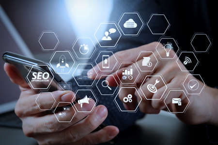 Seo Optimization for website with mobile website and Landing page virtual diagram.businessman hand working with mobile phone and laptop and digital tablet computer in modern office Stok Fotoğraf