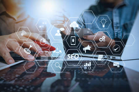 Seo Optimization for website with mobile website and Landing page virtual diagram.Business team meeting present. Photo professional investor working with new startup project. Finance managers meeting.