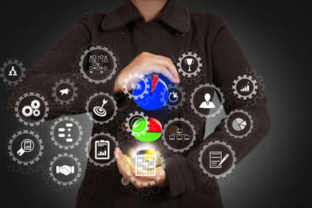 AR virtual screen dashboard with project management with icons of scheduling, budgeting, communication.businesswoman hand shows virtual pie chart