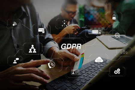 GDPR. Data Protection Regulation with Cyber security and privacy virtual diagram.Coworking process, entrepreneur team working in creative office space. using digital tablet docking keybord and laptop with smartphone. Stock Photo