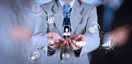 Business process management with workflow automation diagram and gears in virtual flowchart.businessman hand choosing people icon as human resources concept