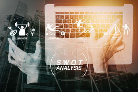 SWOT Analysis virtual diagram with Strengths, weaknesses, threats and opportunities of company.cyber security internet and networking concept.Businessman hand working with VR screen padlock icon mobile phone.