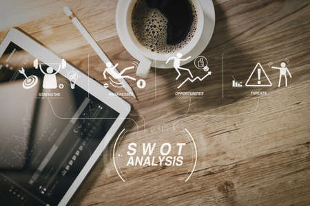 SWOT Analysis virtual diagram with Strengths, weaknesses, threats and opportunities of company.Coffee cup and Digital table dock smart keyboard,eyeglasses,stylus pen on wooden table,filter effect,icons screen