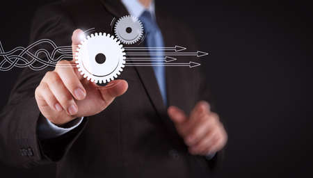 Thinking about structuring virtual diagram of business process with solutions. Businessman hand pressing an imaginary button on virtual screen