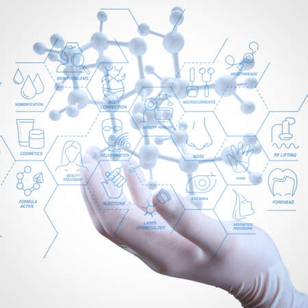 Cosmetology process with Beauty therapy,bodycare,healthcare,wellness treatment virtual diagram and  Correction,rejuvenation,anti-aging procedure.scientist doctor hand holds virtual molecular structure in the lab Reklamní fotografie