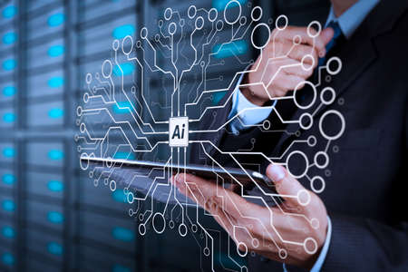 Artificial Intelligence (AI),machine learning with data mining technology on virtual dachboard.businessman hand using tablet computer and server room background. Stock Photo