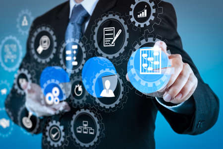AR virtual screen dashboard with project management with icons of scheduling, budgeting, communication.businessman hand drawing a pie chart and 3d graph Banque d'images - 104370022