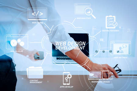 Developing programming and coding technologies with Website design in virtual diagram.Big data analytics with business intelligence (BI) concept.Businessman working in modern office with VR chart and graph with icon Stock Photo