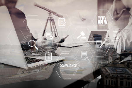 Compliance Virtual Diagram for regulations, law, standards, requirements and audit.co working team meeting concept,businessman using smart phone and digital tablet and laptop computer in modern office. Stock Photo
