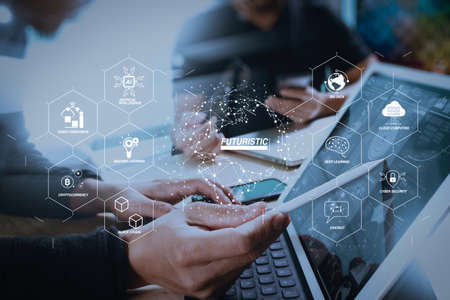 Futuristic in Industry 4.0 and business virtual diagram with Ai, robot assistant, Cloud, big data and automation. two colleague web designer discussing data and digital tablet docking keyboard and computer laptop. Stock Photo