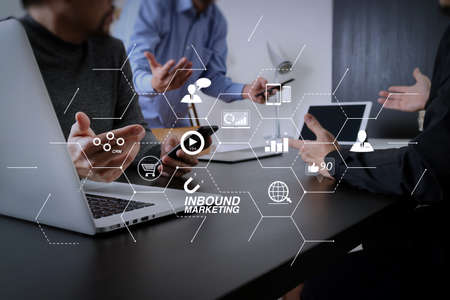 Inbound marketing business with virtual diagram dashboard and Online or permission market concept.co working team meeting concept,businessman using smart phone and digital tablet and laptop computer in modern office.