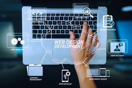 Developing programming and coding technologies with Website design in virtual diagram.businessman typing keyboard with laptop computer on wooden desk in modern office