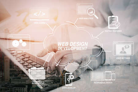 Developing programming and coding technologies with Website design in virtual diagram. businessman typing keyboard with laptop computer and digital tablet on white desk in modern office with city exposure 版權商用圖片