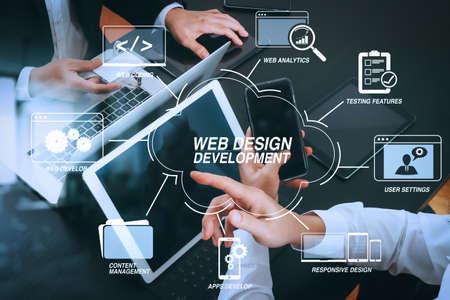 Developing programming and coding technologies with Website design in virtual diagram.co working team meeting concept,businessman using smart phone and digital tablet and laptop computer and name tag in modern office Stok Fotoğraf