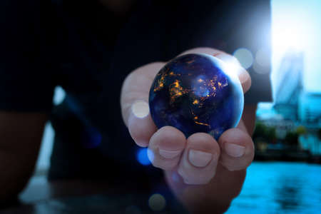 Close up of Earth at night was holding in human hands for Earth day and Energy saving concept,Elements of this image furnished by NASA