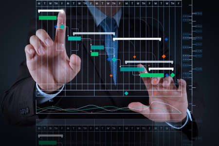Project manager working and update tasks with milestones progress planning and Gantt chart scheduling virtual diagram.businessman hand  working with touch screen in action Stock Photo