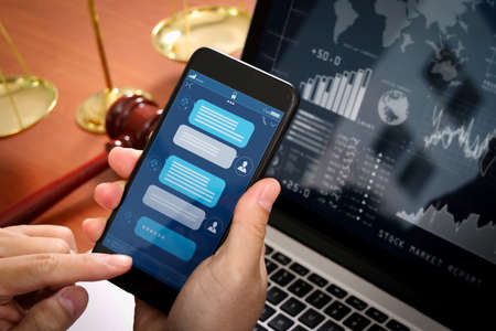Chatbot conversation with smartphone screen app interface and artificial intelligence technology processing virtual assistant with customer support information,Lawyer hand holding mobile phone. Stock fotó - 106949091
