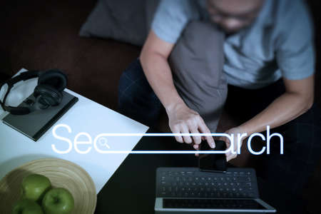 Searching Browsing Internet Data Information Networking Concept with blank search bar.hipster hand using digital tablet docking keyboard and smart phone for mobile payments online business.