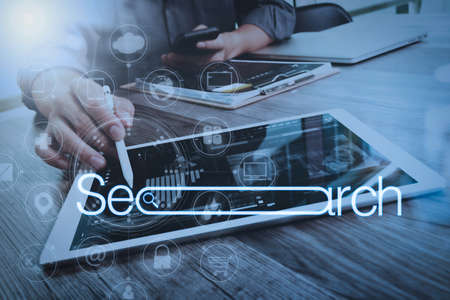 Searching Browsing Internet Data Information Networking Concept with blank search bar.Designer Businessman hand using smart phone,mobile payments online shopping and digital tablet docking keyboard computer.