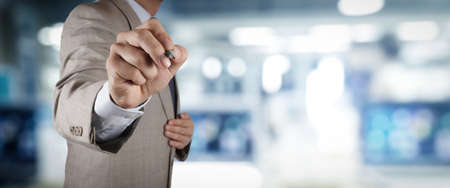 businessman workimg on VR blank wide touch screen computer on office blur background. Reklamní fotografie