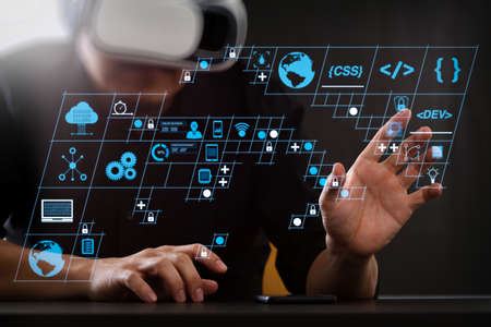 Coding software developer work with AR new design dashboard computer icons of scrum agile development and code fork and versioning with responsive cybersecurity.businessman wearing virtual reality goggles. Stock Photo