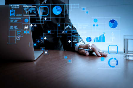 Financial report data of business operations (balance sheet and income statement and diagram) as Fintech concept.businessman hand working with new modern computer and business strategy. Archivio Fotografico