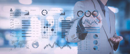 Intelligence (BI) and business analytics (BA) with key performance indicators (KPI) dashboard concept.business documents on office table with smart phone and digital tablet and graph on wide screen computer.