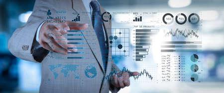 インテリジェンス (BI) とビジネス分析 (BA) 主要業績評価指標 (KPI) ダッシュボードの概念.ビジネス ドキュメントをスマートフォンとデジタル タブレットとグラフを使用したオフィス テーブル上のワイド スクリーン コンピューター。 写真素材 - 107981069