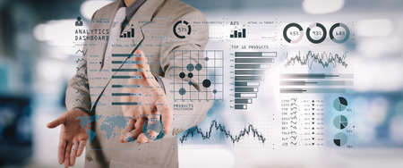 Intelligence (BI) and business analytics (BA) with key performance indicators (KPI) dashboard concept.business documents on office table with smart phone and digital tablet and graph on wide screen co