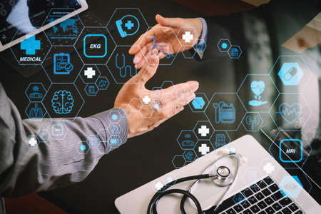 Health care and medical technology services concept with flat line AR interface.Medical and healthcare concept,Doctor and patient shaking hands in modern office at hospital