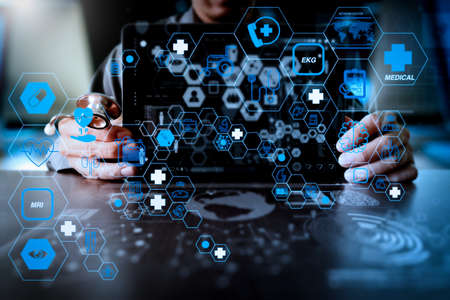 Health care and medical technology services concept with flat line AR interface.Medicine doctor hand working with modern computer interface and digital layer effect as medical network concept 写真素材