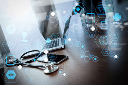 Health care and medical technology services concept with flat line AR interface.team doctor working with laptop computer in medical workspace office as concept 写真素材