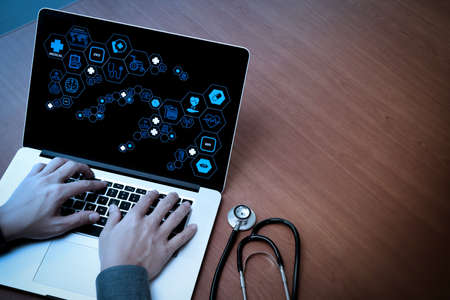 Health care and medical technology services concept with flat line AR interface.Medicine doctor hand working with modern computer and blank screen on wooden desk as medical concept Zdjęcie Seryjne
