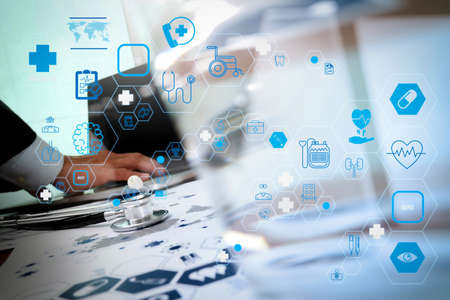 Health care and medical technology services concept with flat line AR interface.doctor working with laptop computer in medical workspace office and medical network media diagram as concept