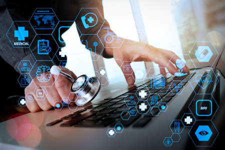 Health care and medical technology services concept with flat line AR interface.Doctor working at workspace with laptop computer in medical workspace office