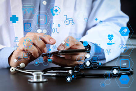 Health care and medical technology services concept with flat line AR interface.smart medical doctor working with smart phone and stethoscope on dark wooden desk
