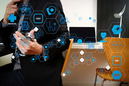Health care and medical technology services concept with flat line AR interface.smart medical doctor working with smart phone and digital tablet and laptop computer and stethoscope in modern office at hospital 写真素材
