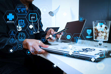 Health care and medical technology services concept with flat line AR interface.smart medical doctor working with smart phone and digital tablet and laptop computer and stethoscope on wood desk in modern office 写真素材