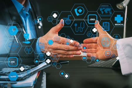 Health care and medical technology services concept with flat line AR interface.Medical and health care concept,Doctor and patient shaking hands in modern office at hospital Standard-Bild