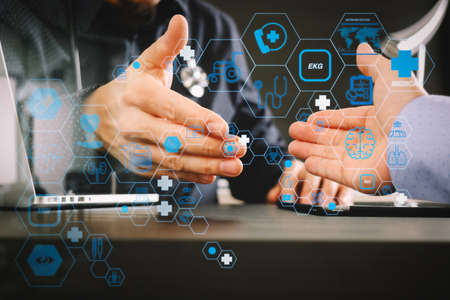 Health care and medical technology services concept with flat line AR interface.Medical and health care concept,Doctor and patient shaking hands in modern office at hospital 写真素材