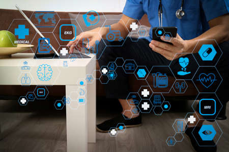 Health care and medical technology services concept with flat line AR interface.doctor hand working with smart phone,digital tablet computer,stethoscope,sitting on sofa in living room