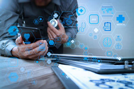 Health care and medical technology services concept with flat line AR interface.Doctor hand working with modern smart phone with medical chart interface,multi channel connection,white background 写真素材