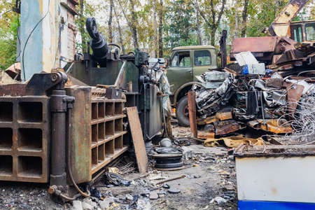 Scrap yard, metal for recycling, press for non-ferrous metal. Stok Fotoğraf