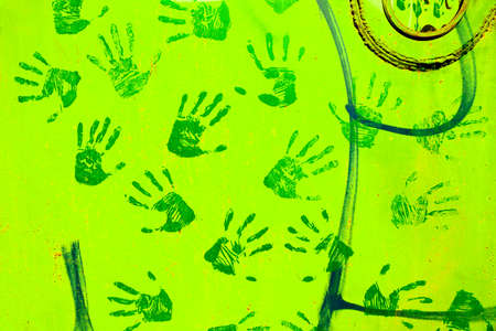 Green handprints on the metal surface. Banque d'images