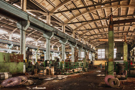 An abandoned old large industrial hall is waiting to be demolished. Former Khabarovsk plant for the production of diesel engines.