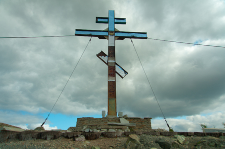 Pious cross on the mountain, Karabash. Editorial use only