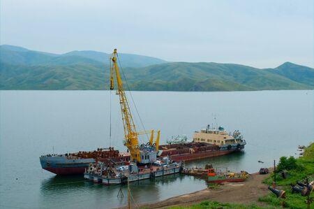 Loading of scrap metal onto a cargo ship