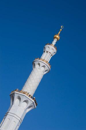 sheikh zayed mosque: Sheikh Zayed Mosque in Abu Dhabi, United Arab Emirates - detail of minarets against blue sky.